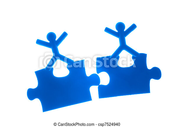 Two people rise hands on top of puzzles - csp7524940
