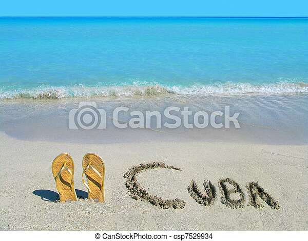 Gold sandals on the shoreline of a tropical beach in Cuba - csp7529934