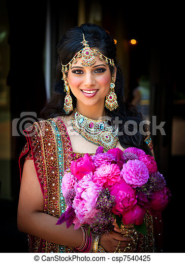 Smiling Indian Bride with Bouquet - csp7540425
