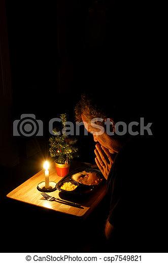 Praying over TV Dinner - csp7549821