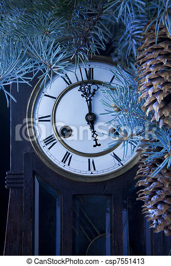 midnight antique clock and a Christmas tree - csp7551413