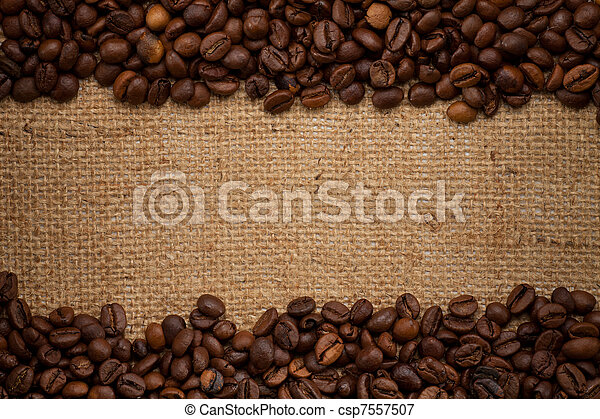 coffee beans on burlap background - csp7557507