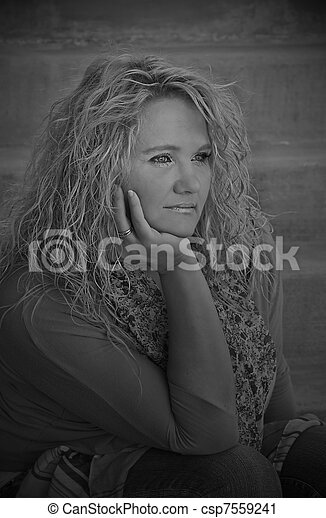 Pretty Mid Life Caucasian Woman on Stairs Black and White - csp7559241