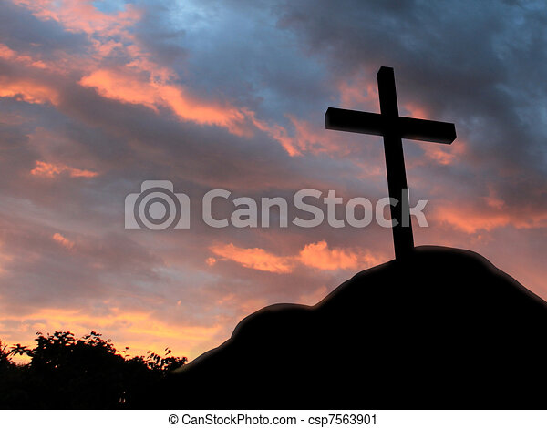 Cross on a hill with cloudy background - csp7563901