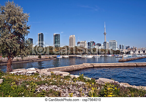 blue panoramic skies above Toronto CN Tower overlooking the luxury high rise apartments along the harbour waterfront of Lake Ontario, Toronto, Canada. - csp7564010