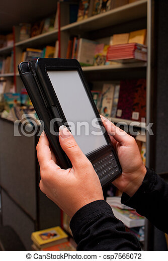 Woman's hands holding electronic book reader - csp7565072
