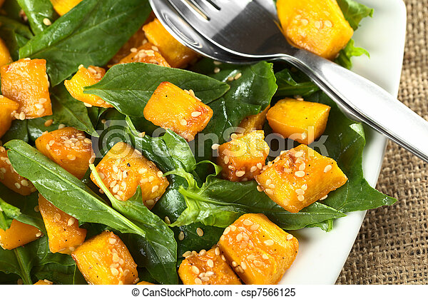 Baked pumpkin, spinach and sesame salad - csp7566125