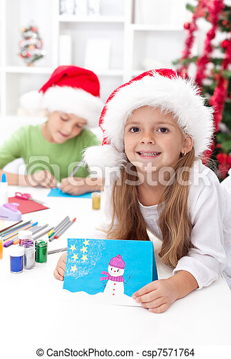 Kids making christmas greeting cards - csp7571764