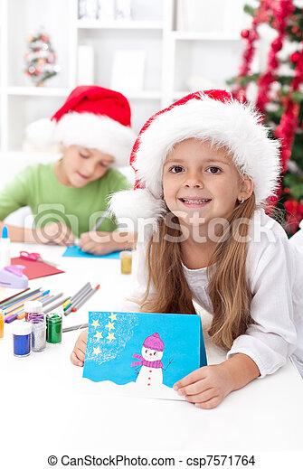 Kids making christmas greeting cards - csp7571764