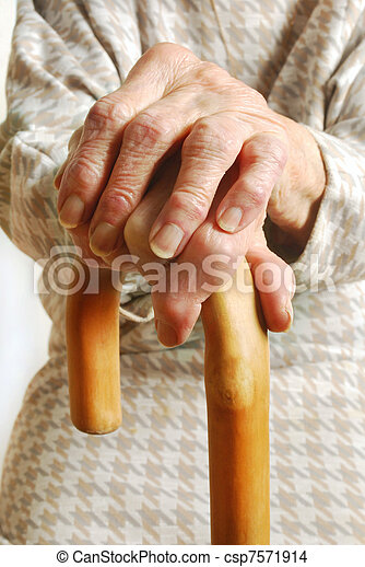 Old Ladies hands with walking stick - csp7571914