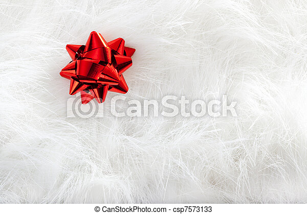 Christmas red ribbon look over white fur - csp7573133