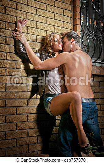 sexy loving couple in the dark - csp7573701