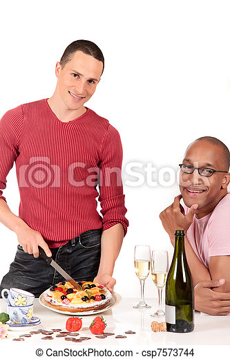 Mixed ethnicity  gay couple kitchen - csp7573744