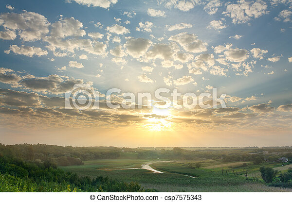 Magic summer sunset over rural expanses - csp7575343