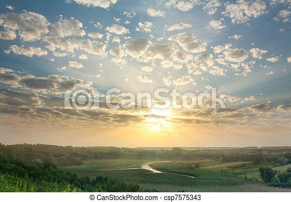 Magic summer sunset over rural expanses - csp7575343