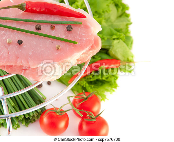 Meat, an onion and pepper on a grill, spring vegetables