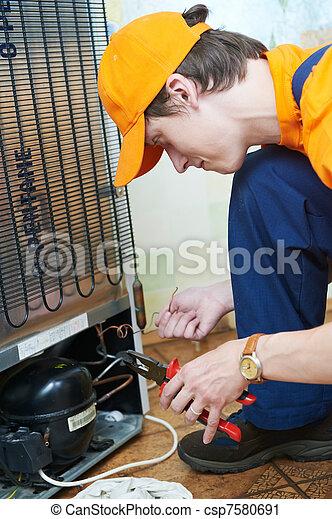 repair work on fridge appliance - csp7580691