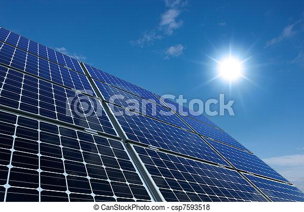 Solar panels against a sunny sky - csp7593518