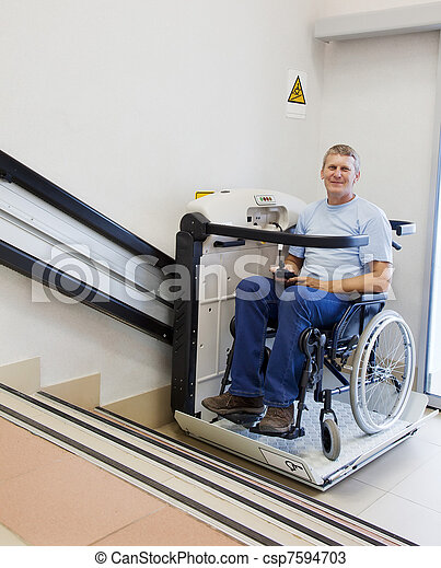 man in an invalid chair walks upstairs on the special elevating device - csp7594703