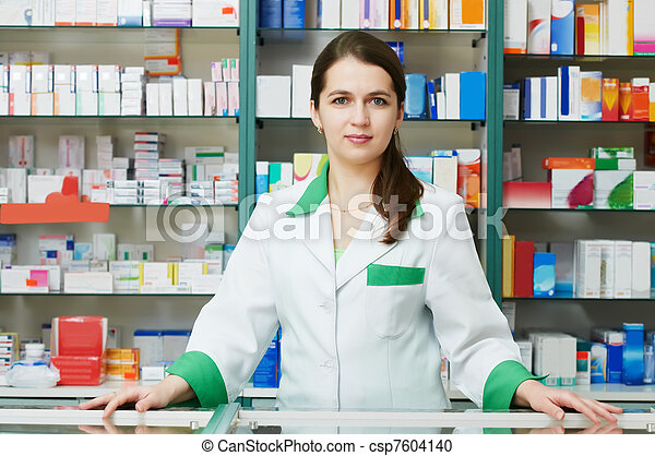 Pharmacy chemist woman in drugstore - csp7604140