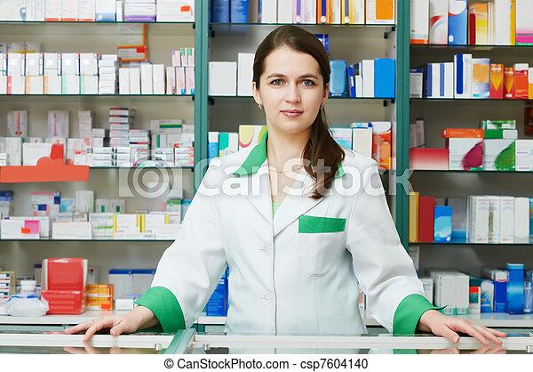 Pharmacy chemist woman in drugstore - csp7604140