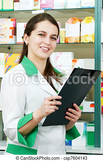 Pharmacy chemist woman in drugstore - csp7604143