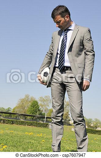 Business man coaching soccer