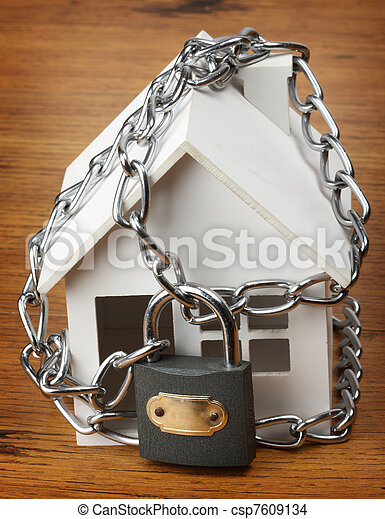 house with chain and padlock, - csp7609134