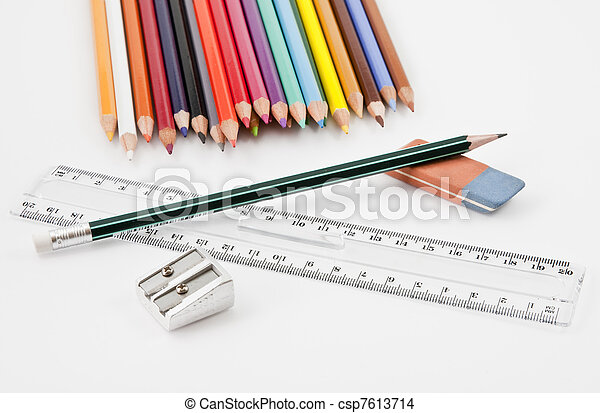 Basic school supplies with colored pencils, pencil,  eraser, sharpener and plastic ruler - csp7613714