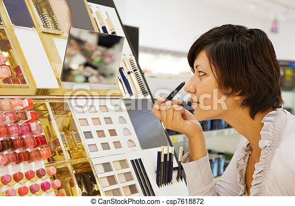 woman chooses the cosmetic