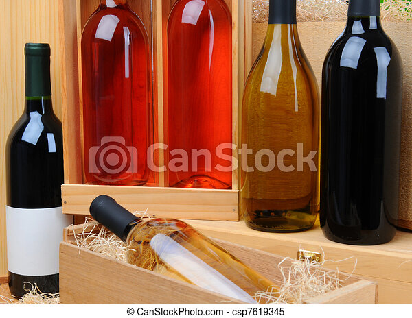 Assortment of wine bottles on crates - csp7619345