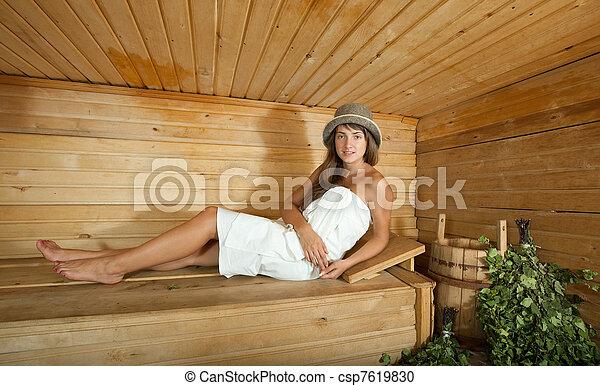 stock fotografie von frau in sauna angezogene frau liegen auf h lzern csp7619830. Black Bedroom Furniture Sets. Home Design Ideas