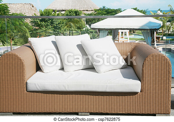 Outside lounge area nice framed with plants, flowers, pool and beach.  - csp7622875