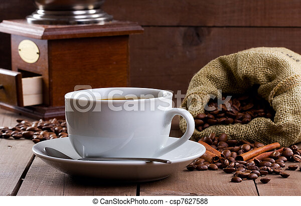 cup of coffee with beans - csp7627588