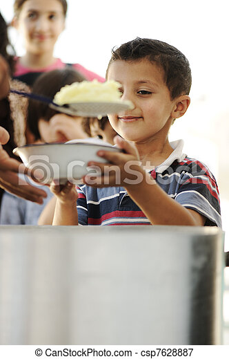 Hungry children in refugee camp, distribution of humanitarian food - csp7628887
