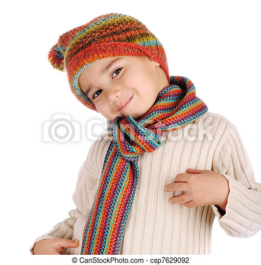 Cute kid with winter clothes isolated in studio - csp7629092
