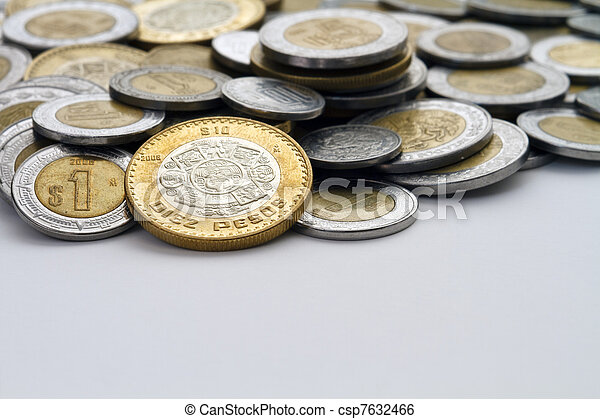 Ten Mexican Peso coin at the edge of other Pesos - csp7632466