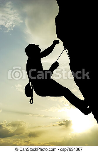 Silhouette of climber at the sunset. - csp7634367