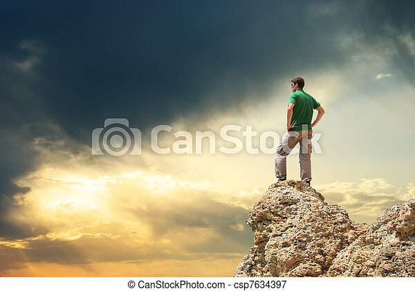 Man on peak of mountain. - csp7634397