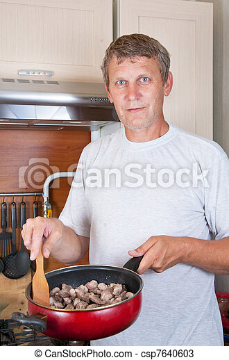 mature man makes supper - csp7640603
