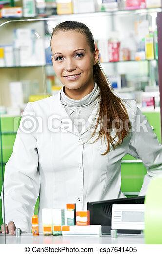Pharmacy chemist woman in drugstore - csp7641405