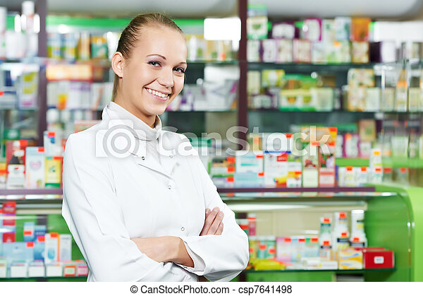 Pharmacy chemist woman in drugstore - csp7641498