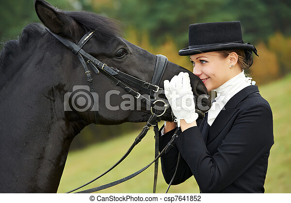 horsewoman jockey in uniform with horse - csp7641852