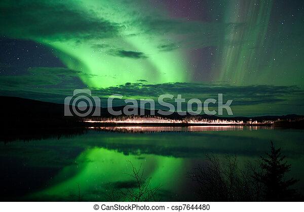 Stars and Northern Lights over dark Road at Lake - csp7644480