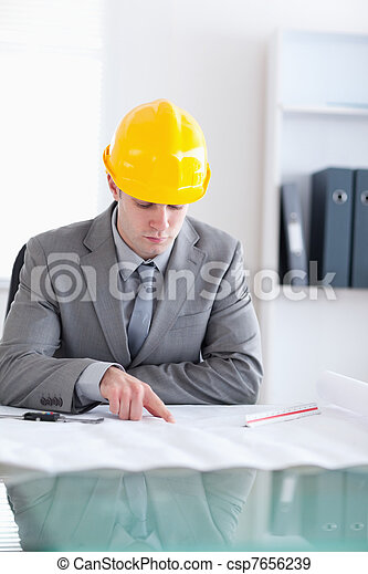 Close up of architect checking a plan - csp7656239