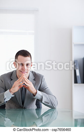 Close up of young businessman in a successful negotiation - csp7656460