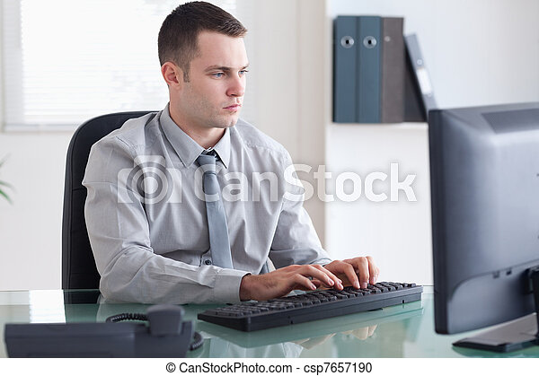 Businessman typing on his computer - csp7657190