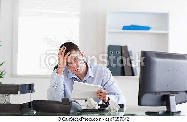 Businessman worried about invoice - csp7657642