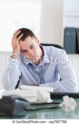Close up of businessman being depressed by accounting - csp7657766