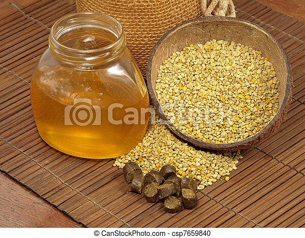 Honey jar, flowers pollen and  propolis. - csp7659840